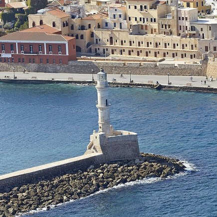 The Lighthouse of Chania in old port, Crete by Tripinview