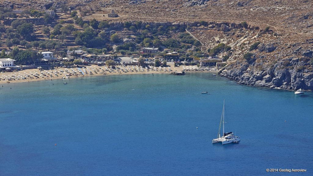 Aerial photo of Lindos beach, Rhodes by Tripinview