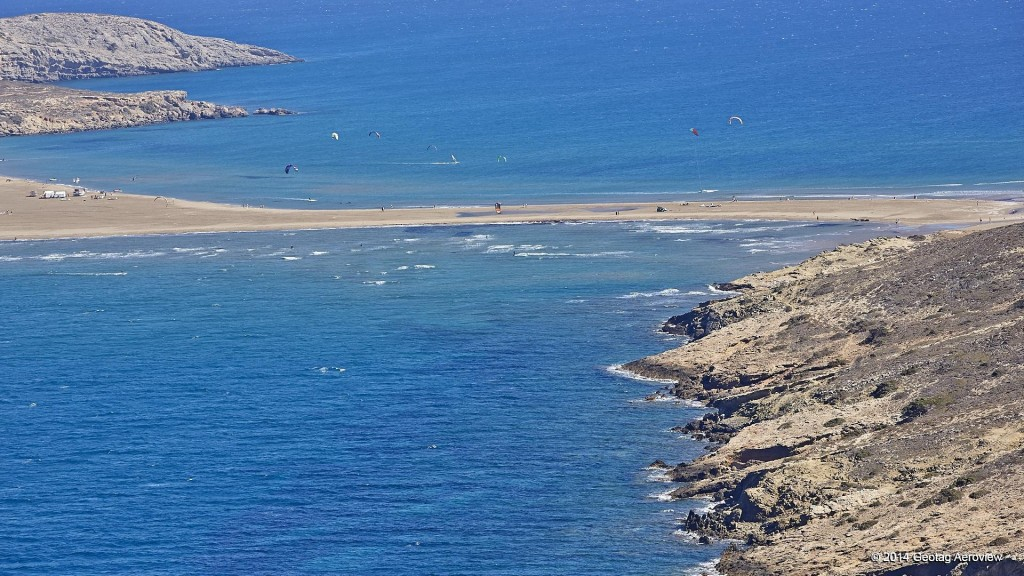 Aerial photo of Prassonissi beach, ideal place for windsurfing in the island of Rhodes by Tripinview