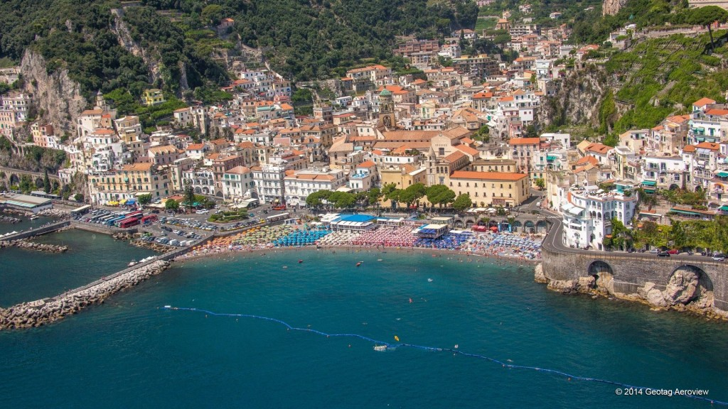 Aerial photo of the Amalfi village and beach by Tripinview