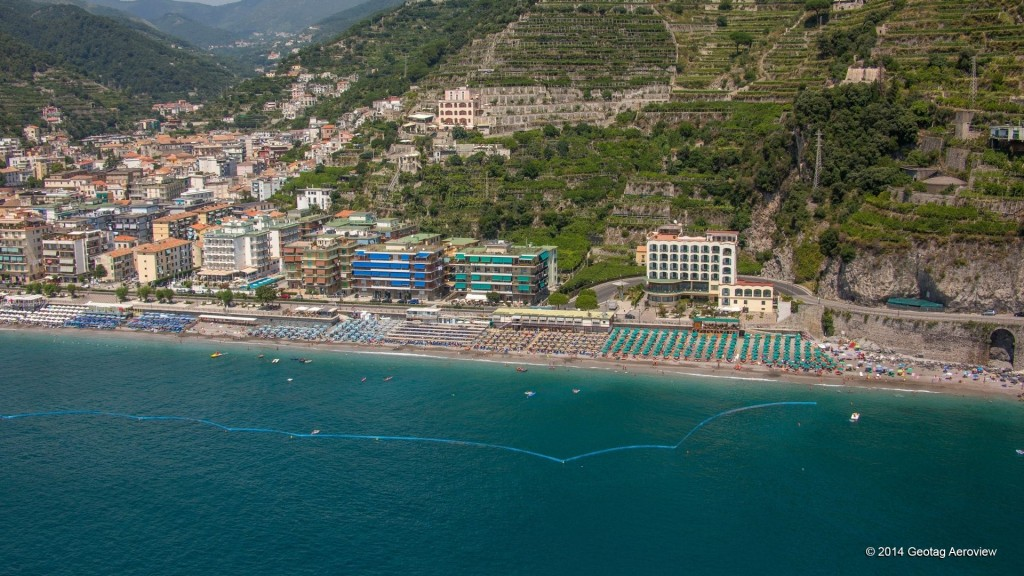 Aerial photo of the main beach of Maiori by Tripinview