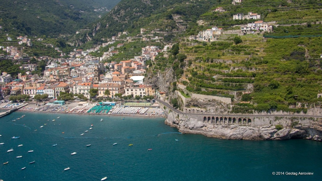 Aerial photo of the main beach of Minori by Tripinview